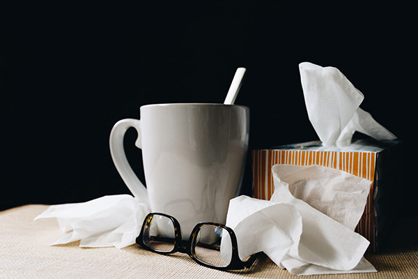 mug, glasses and tissues